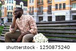disappointed male sitting... | Shutterstock . vector #1250875240