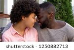 young man and woman nuzzling ...   Shutterstock . vector #1250882713