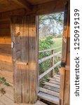 wood door in the park | Shutterstock . vector #1250919139
