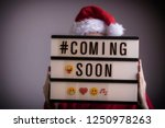 santa with lightbox. 'coming... | Shutterstock . vector #1250978263