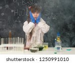 excited schoolgirl in fume... | Shutterstock . vector #1250991010