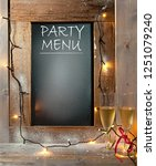champagne glasses next to menu... | Shutterstock . vector #1251079240