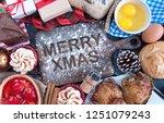 merry xmas written in flour on... | Shutterstock . vector #1251079243