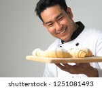 smart young asian chef  cooking ... | Shutterstock . vector #1251081493