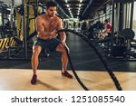 muscular man working out with...   Shutterstock . vector #1251085540