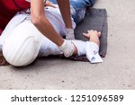 first aid after work accident   Shutterstock . vector #1251096589