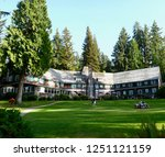 Quinault, Washington, August 2015.  Summer establishing wide-shot of Lake Quinault Lodge on the shores of Lake Quinault, Olympic National Park.  - stock photo