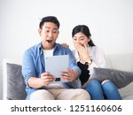 happy asian couple lover using... | Shutterstock . vector #1251160606
