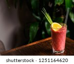 glass of berry smoothie... | Shutterstock . vector #1251164620