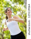 Healthy Woman Jogging Outdoors...