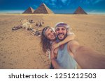 happy tourist couple on camel... | Shutterstock . vector #1251212503