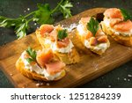 antipasti snacks for wine.... | Shutterstock . vector #1251284239