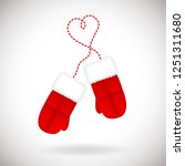 a pair of red warm mittens with ... | Shutterstock .eps vector #1251311680