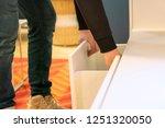 close up hand opens the shelf... | Shutterstock . vector #1251320050