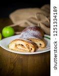 sweet homemade strudel with... | Shutterstock . vector #1251334189