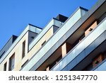 modern apartment buildings on a ... | Shutterstock . vector #1251347770