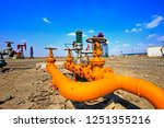 oil pipes and valves | Shutterstock . vector #1251355216