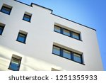 modern apartment buildings on a ... | Shutterstock . vector #1251355933