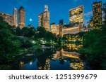 the pond and midtown manhattan... | Shutterstock . vector #1251399679