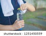 sport woman. rest.drink water.... | Shutterstock . vector #1251450559