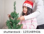 asian little girl with mother... | Shutterstock . vector #1251489436