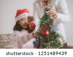 asian little girl with mother... | Shutterstock . vector #1251489439