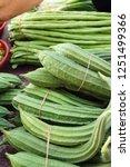 luffa acutangula at street food | Shutterstock . vector #1251499366