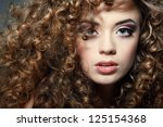 young beautiful woman with long ... | Shutterstock . vector #125154368