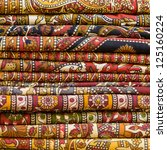 heap of cloth fabrics at a...
