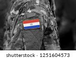 flag of paraguay on soldier arm.... | Shutterstock . vector #1251604573
