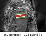 flag of suriname on soldier arm.... | Shutterstock . vector #1251604576