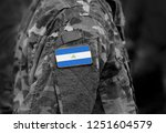flag of nicaragua on soldier... | Shutterstock . vector #1251604579