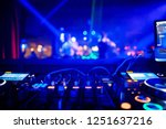 dj behind the decks in a... | Shutterstock . vector #1251637216