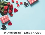 Stock photo valentine s day card composition with gifts red hearts on blue surface top view space for text 1251677299