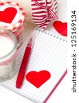 hearts  notebooks and candles... | Shutterstock . vector #125169134