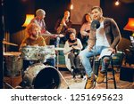 multicultural band practicing...   Shutterstock . vector #1251695623