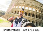 Stock photo happy tourist taking a selfie at the colosseum rome italy 1251711133