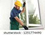 construction worker installing... | Shutterstock . vector #1251774490