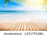 blur tropical beach with bokeh... | Shutterstock . vector #1251791086