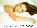 Beautiful happy smiling young woman in bed at home - stock photo