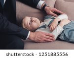 cropped image of father in suit ... | Shutterstock . vector #1251885556