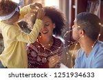 beautiful young family enjoying ... | Shutterstock . vector #1251934633