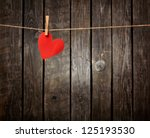 red paper heart hanging on the... | Shutterstock . vector #125193530