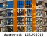 the glass facade of residential ... | Shutterstock . vector #1251939013