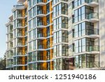 the glass facade of residential ... | Shutterstock . vector #1251940186