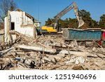 the excavator loads the remains ... | Shutterstock . vector #1251940696