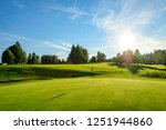 nice evening scenery on a golf... | Shutterstock . vector #1251944860