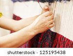 Woman Hands Weaving Carpet...