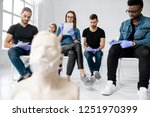 group of young people sitting... | Shutterstock . vector #1251970399