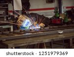 man welding in workshop | Shutterstock . vector #1251979369